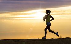 Woman Running At Sunset Wallpaper Mural